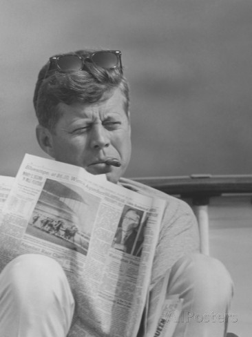 stocktrek-images-president-john-f-kennedy-smoking-a-cigar-and-reading-the-newspaper