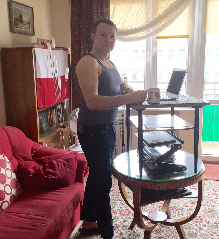 Me in Warsaw at my improvised, standing desk.