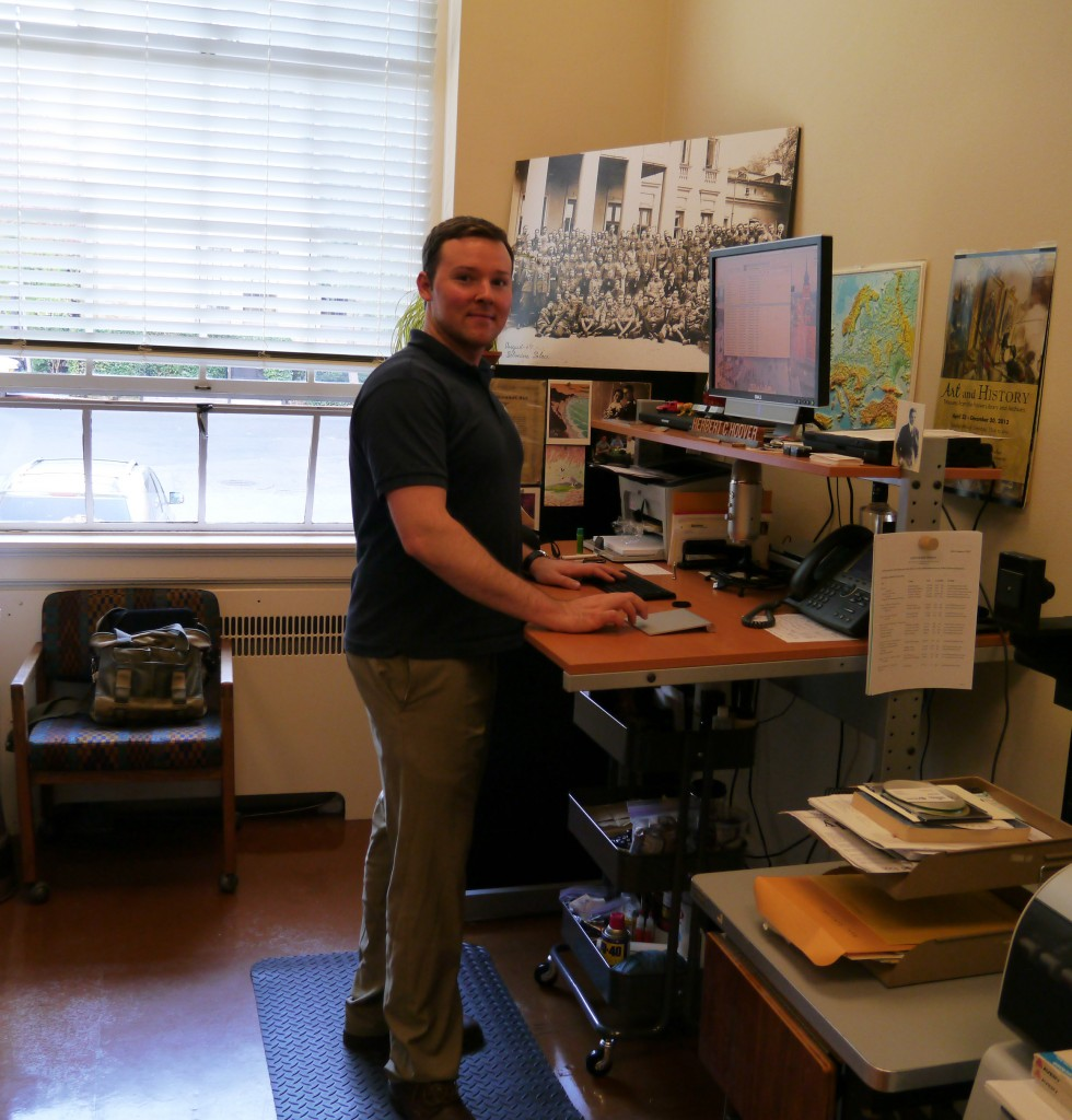 Me at my standing desk (originally a drafting table) at work.